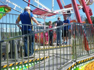Boys getting off ferris wheel- Lines From The Vine- http://www.LinesFromTheVine.com